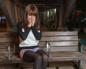 Sad Asian Woman on a Park Bench — Stock Photo