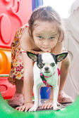 Young girl and puppy at playground — Stock Photo