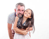 Caucasian dad holding Asian daughter — Stock Photo