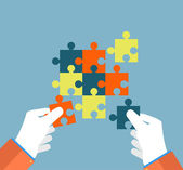Businessman assembling jigsaw puzzle — Stock Vector