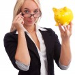 Stockfoto: Young womwatching piggy bank
