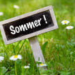 Sommer signboard in the meadow angular — Stock Photo