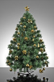 Christmas tree with grey stage — Stock Photo