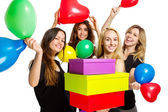 Girls having a party with baloons and boxes — Stock Photo