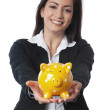 Asian Businesswoman presenting piggy bank — Stockfoto
