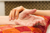 Young hands caring for old hands — Stock Photo