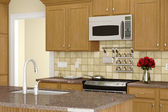 Kitchen with sink in front — Stock Photo