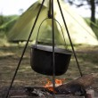 Pot on a fire against the tent — Stock Photo