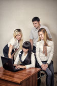 Group of workers confer in office — Stock Photo