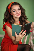 Girl in retro style with emotions reading a book — Stock Photo