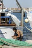Fisherman making a net — Foto de Stock