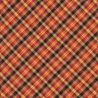 Yellow Red and Black Diagnal Plaid Textile Background — Stock Photo