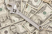Adjustable Wrench On Pile Of American Money — Stock Photo