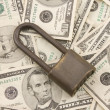 Royalty-Free Stock Photo: Padlock Obn Pile Of American Money