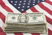 Stack of Money On American Flag — Stock Photo