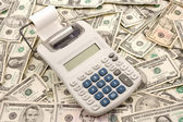 Calculater On Pile of American Money — Stock Photo