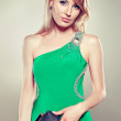 Blonde woman in green dress — Stock Photo