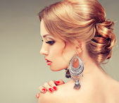 Woman with earrings — Stock Photo