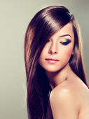 Brunette with long hair and modern make-up — Stock Photo