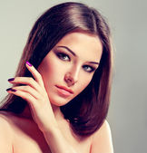 Model with violet manicure — Stock Photo