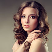 Beautiful brunette woman with curly hair — Stock Photo