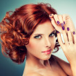 图库照片: Redhead woman with bright makeup and manicure