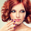 Redhead woman with bright makeup and manicure looking to the left — Stockfoto #35390963