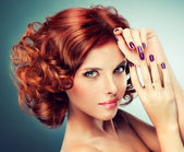 Redhead woman with bright makeup and manicure — Stock Photo