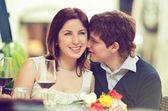 Couple kissing in restaurant — Foto Stock