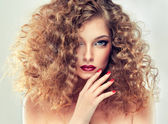 Model with curly hair — Stock Photo
