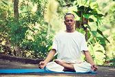 Man doing yoga — Stock Photo