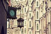Lantern and clock on building — Stock Photo