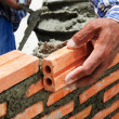 Construction mason worker bricklayer installing brick — Stock Photo