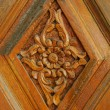 Carved pattern on wood, element of decor — Stock Photo