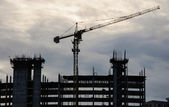 High rise building under construction. The site with cranes as a — Stock Photo