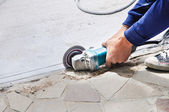 Two worker hands cutting the stone — Stock Photo
