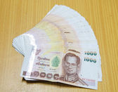 Thai money on wooden table. — Foto Stock