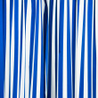 Blue and white curtain — Stockfoto