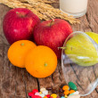 Medicines and fruits — Stock Photo