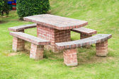 Brick table and chairs — Stok fotoğraf
