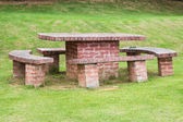 Brick table and chairs — 图库照片