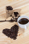 Coffee beans in heart shape — Stock Photo