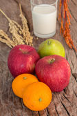Healthy fruits and milk — Stock Photo