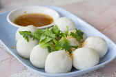 Steamed fish balls with spicy dip — Stock Photo