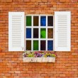 Wooden window on the vintage brick wall — Stock Photo