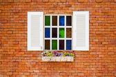Wooden window on the vintage brick wall — Stockfoto