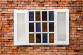 Wooden window on the vintage brick wall — Stok fotoğraf
