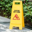 Caution wet floor sign in the garden — Stock Photo
