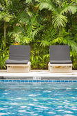 Pool bed beside swimming pool — Foto Stock