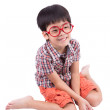 Cute little boy sitting and smiling — Stock Photo